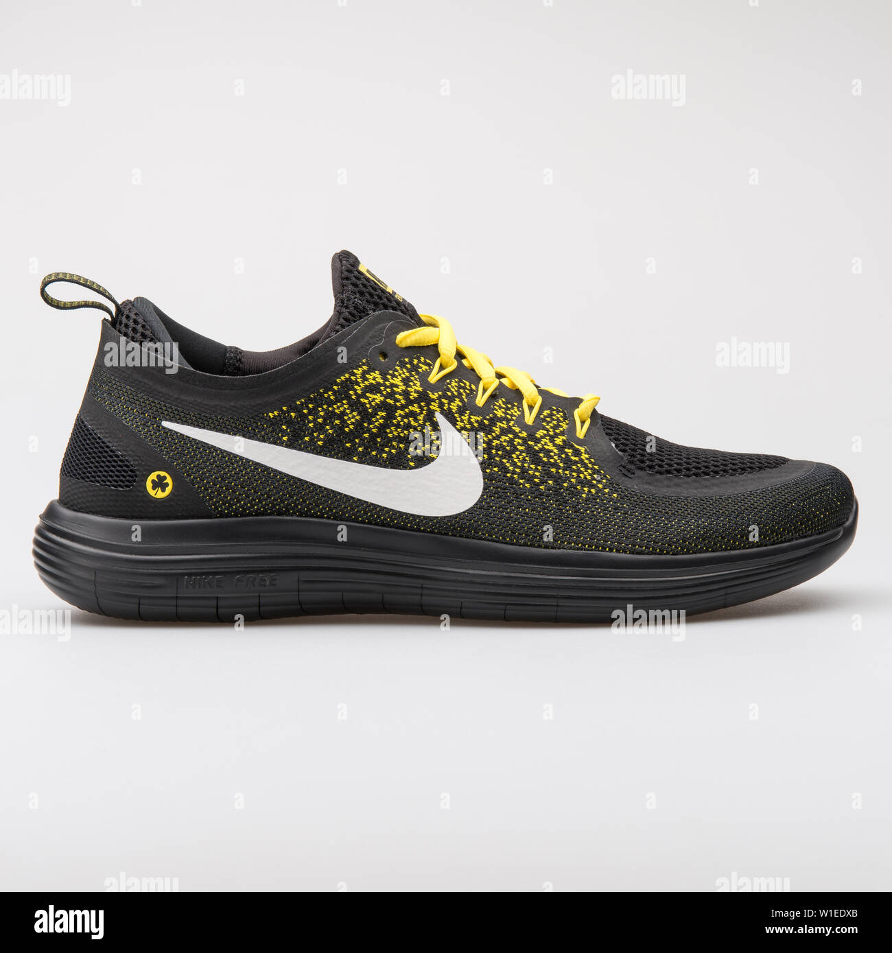 capacidad letra Medición  VIENNA, AUSTRIA - AUGUST 7, 2017: Nike Free RN Distance 2 BSTN black and  yellow sneaker on white background Stock Photo - Alamy