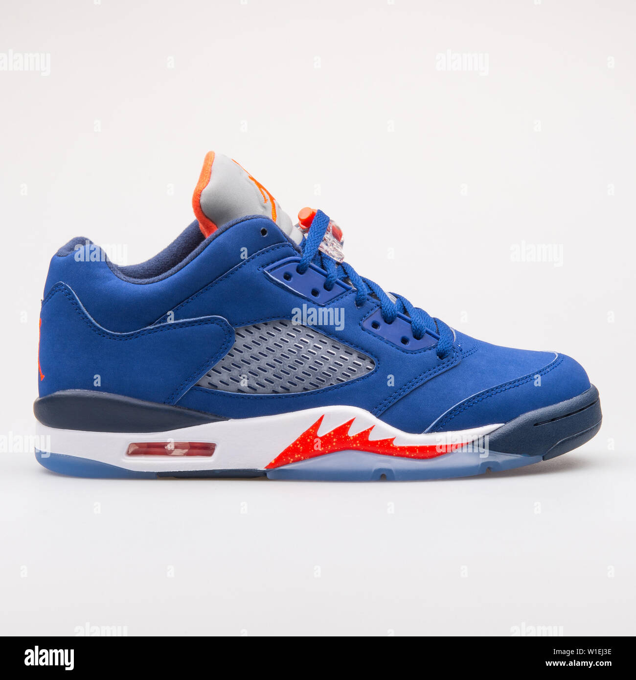 d44ab475 VIENNA, AUSTRIA - AUGUST 23, 2017: Nike Air Jordan 5 Retro Low Knicks blue  and red sneaker on white background.