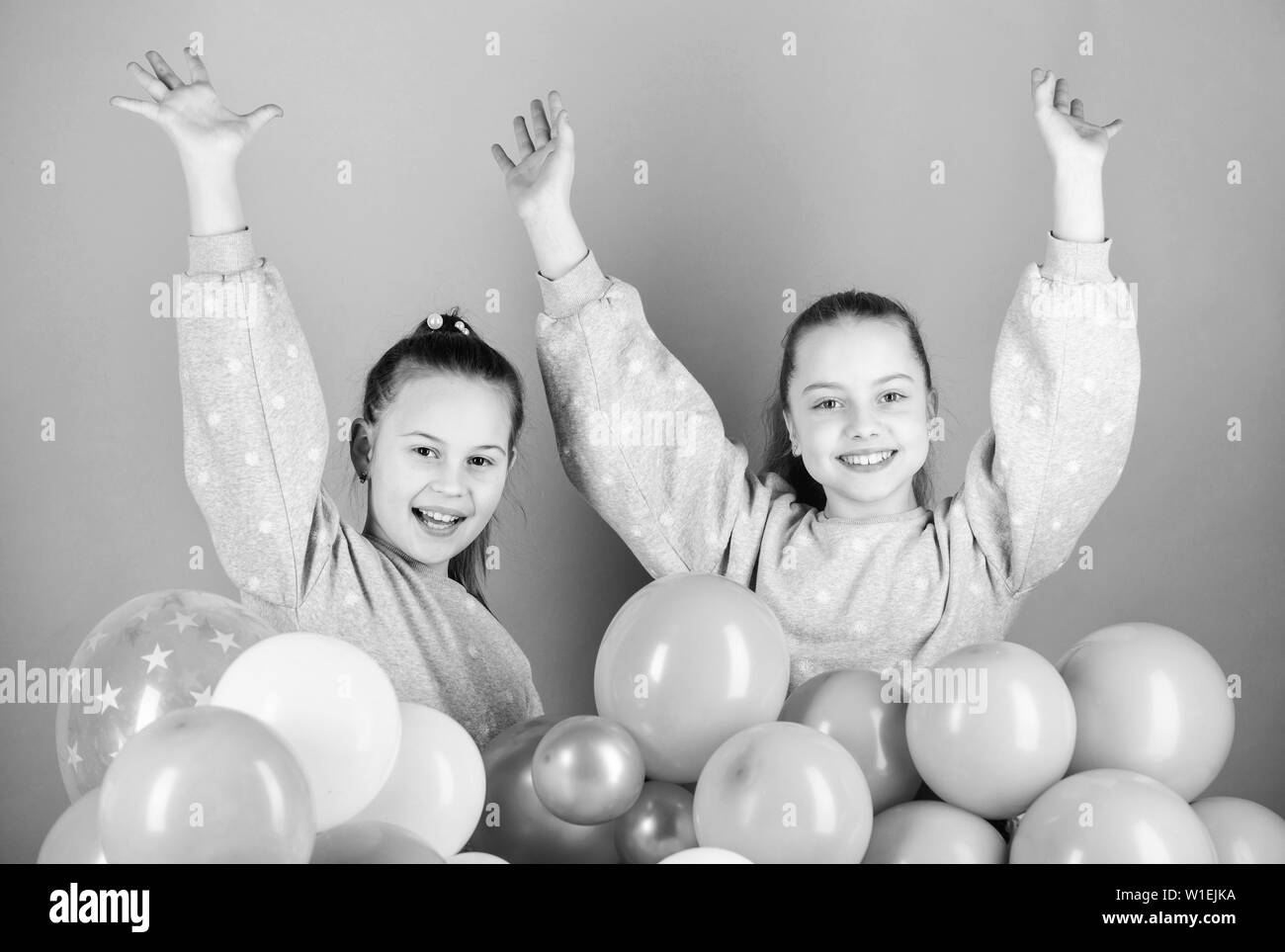 Sisters organize home party. Having fun concept. Balloon theme party. Girls best friends near air balloons. Birthday party. Happiness and cheerful moments. Carefree childhood. Start this party. - Stock Image