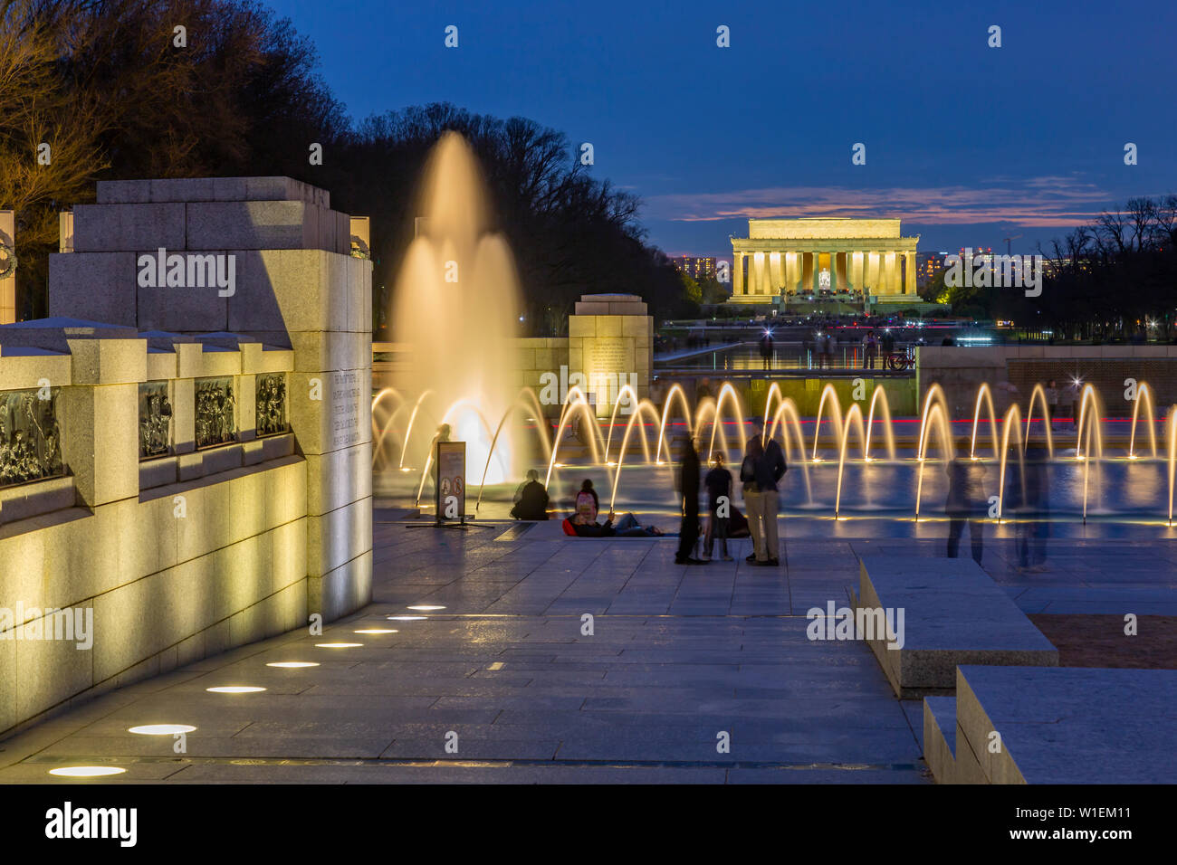 View of the World War Two Memorial and Lincoln Memorial illuminated at dusk, Washington, D.C., United States of America, North America Stock Photo