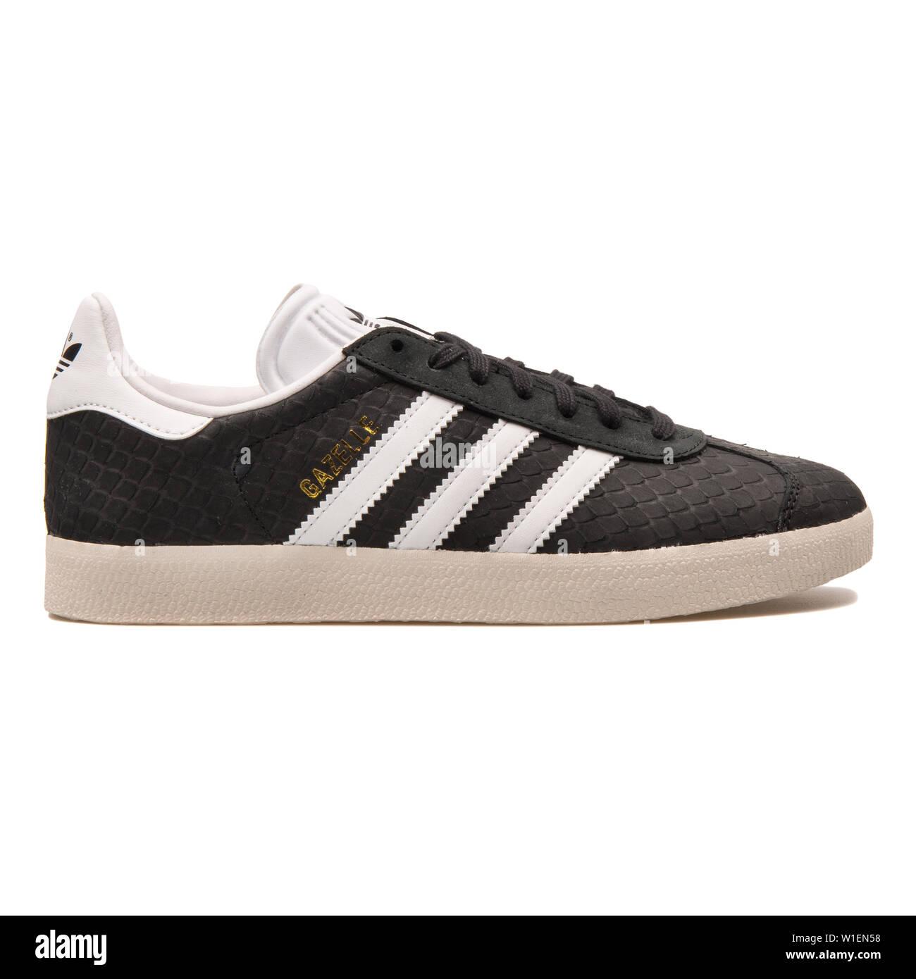75f0a001 VIENNA, AUSTRIA - AUGUST 30, 2017: Adidas Gazelle black and white sneaker on
