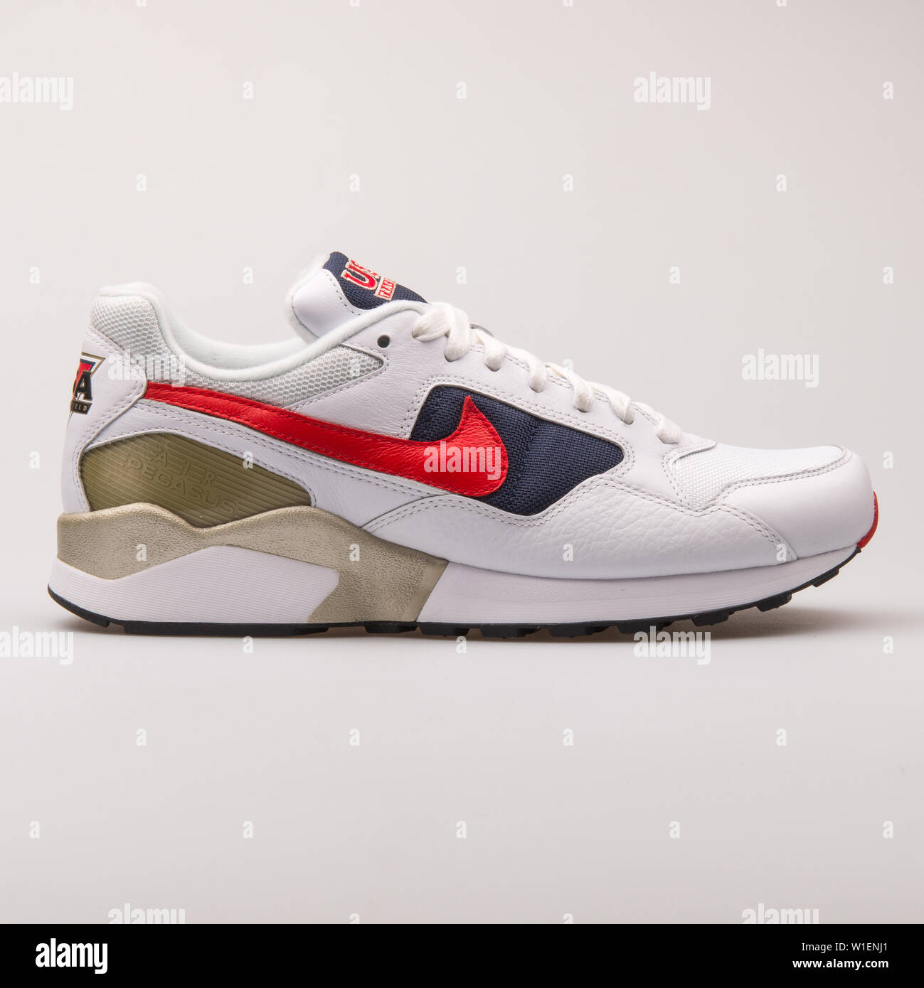 sports shoes 8120f 9726b VIENNA, AUSTRIA - AUGUST 30, 2017  Nike Air Pegasus 92 Premium white, gold,  red and blue sneaker on white background.