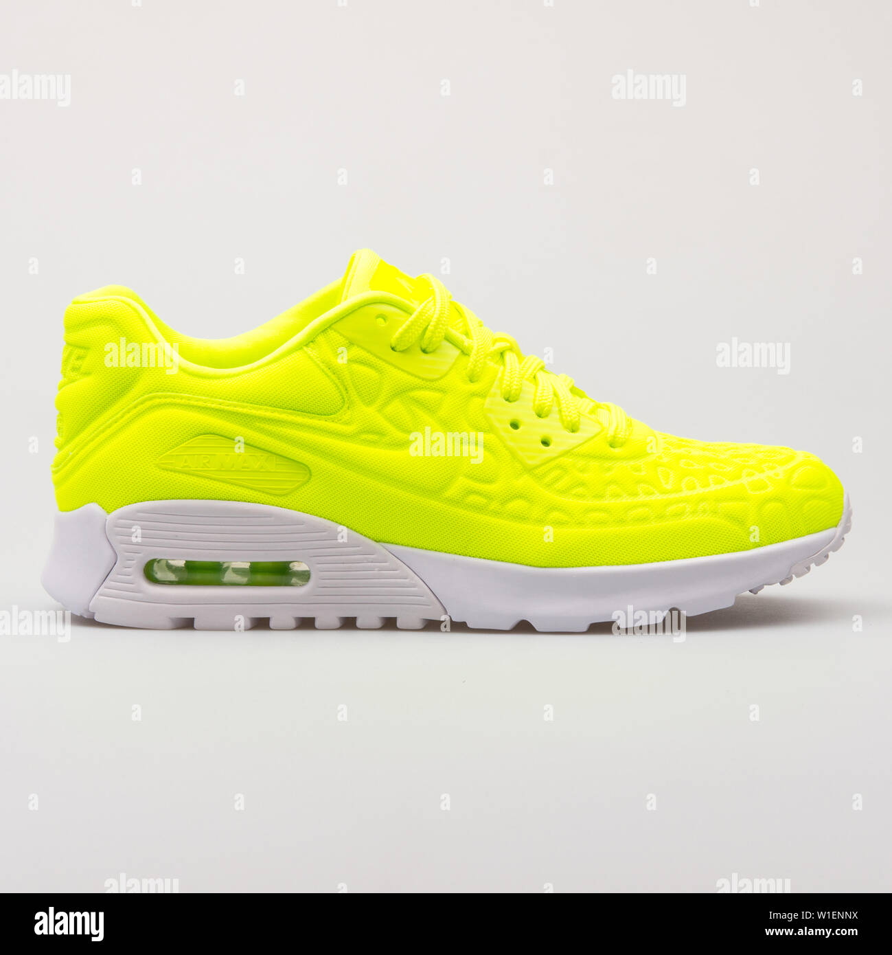 detailed look 61493 746ff VIENNA, AUSTRIA - AUGUST 30, 2017  Nike Air Max 90 Ultra Plush volt yellow  sneaker on white background.