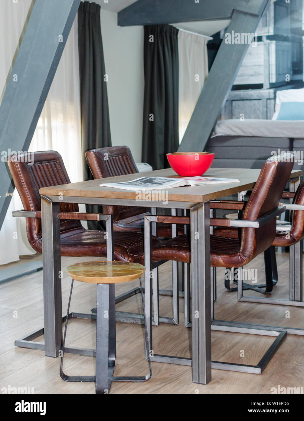 Amsterdam Netherlands May 2019 Wood And Metal Dining Table With Cozy Leather Chairs Wooden Floor In A Mansard Room With A Rented Apartment Stock Photo Alamy