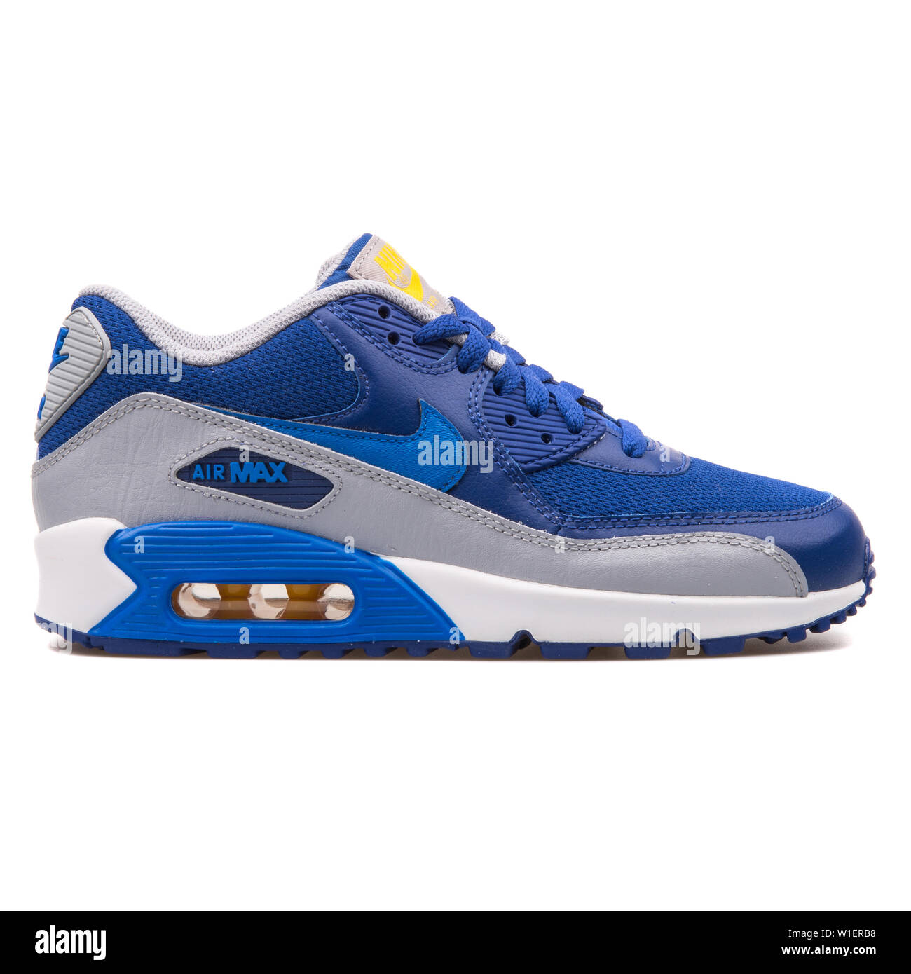 Nike Grey And Blue Sneakers Stock Photos & Nike Grey And
