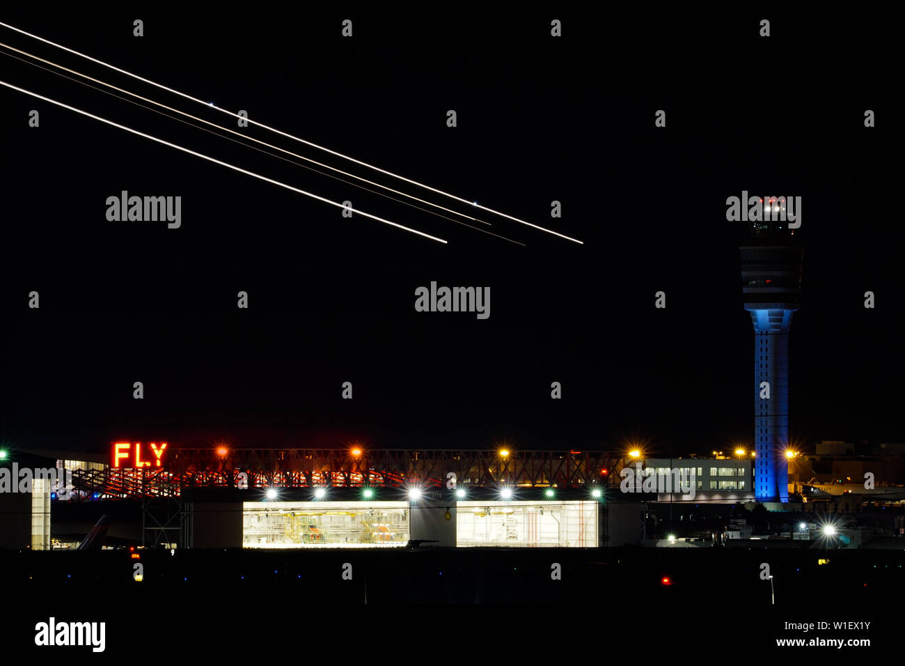Atlanta, GA / USA : 27. May, 2015 - nightime view of the Atlanta international airport with air traffic control and streaks of planes taking off over Stock Photo