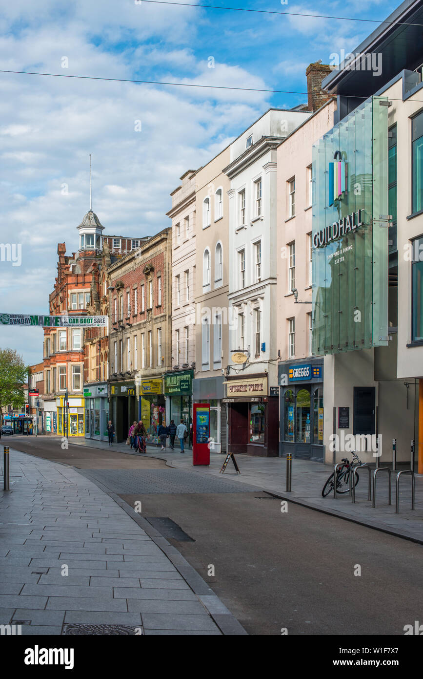 Exeter city High st with the Guildhall Shopping centre in Devon, England, UK. - Stock Image