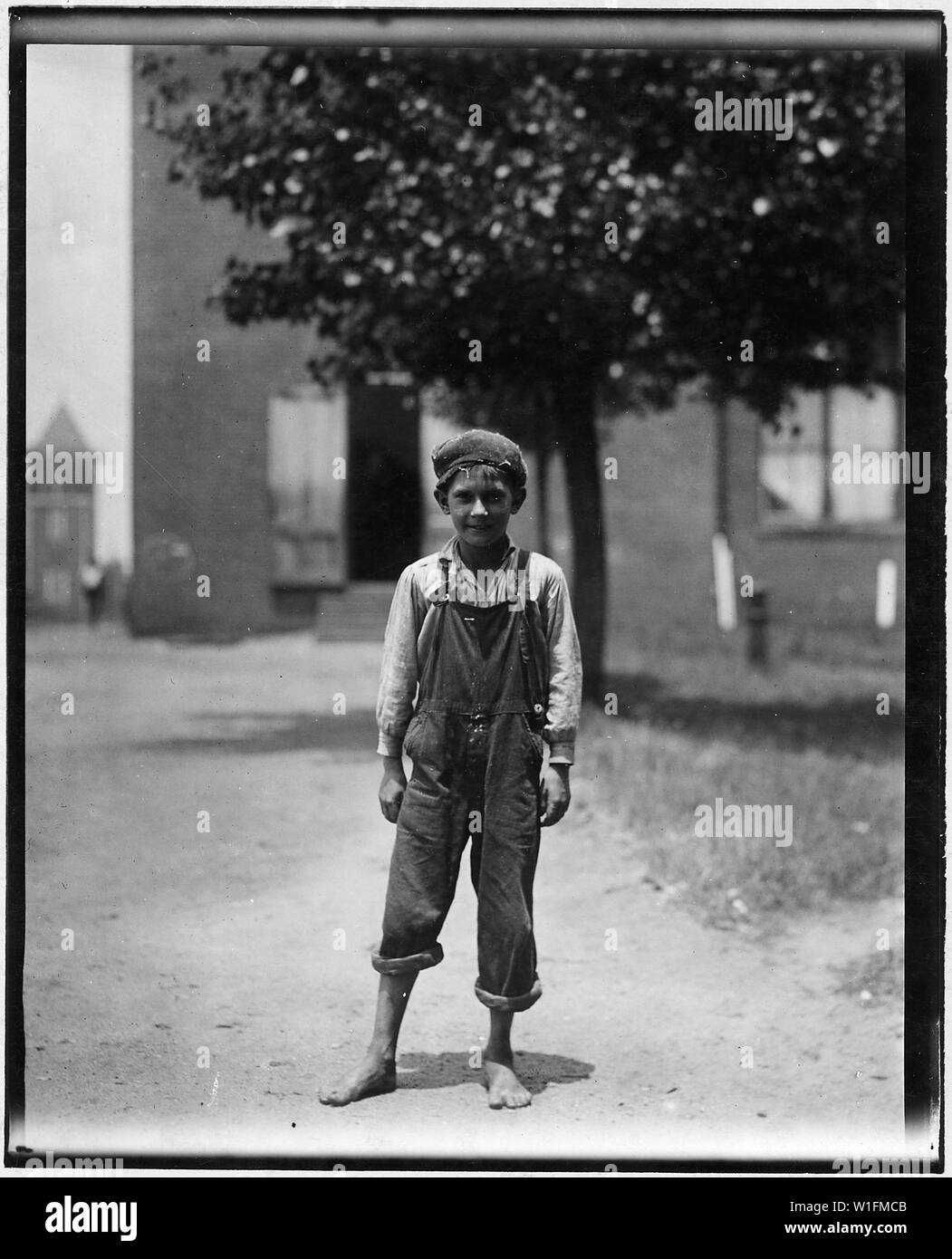 Johnnie Beam, one of the young workers in the Pelzer Mfg. Co. Been working there over a year. Appears to be under 12 years old. Pelzer, S.C. - Stock Image