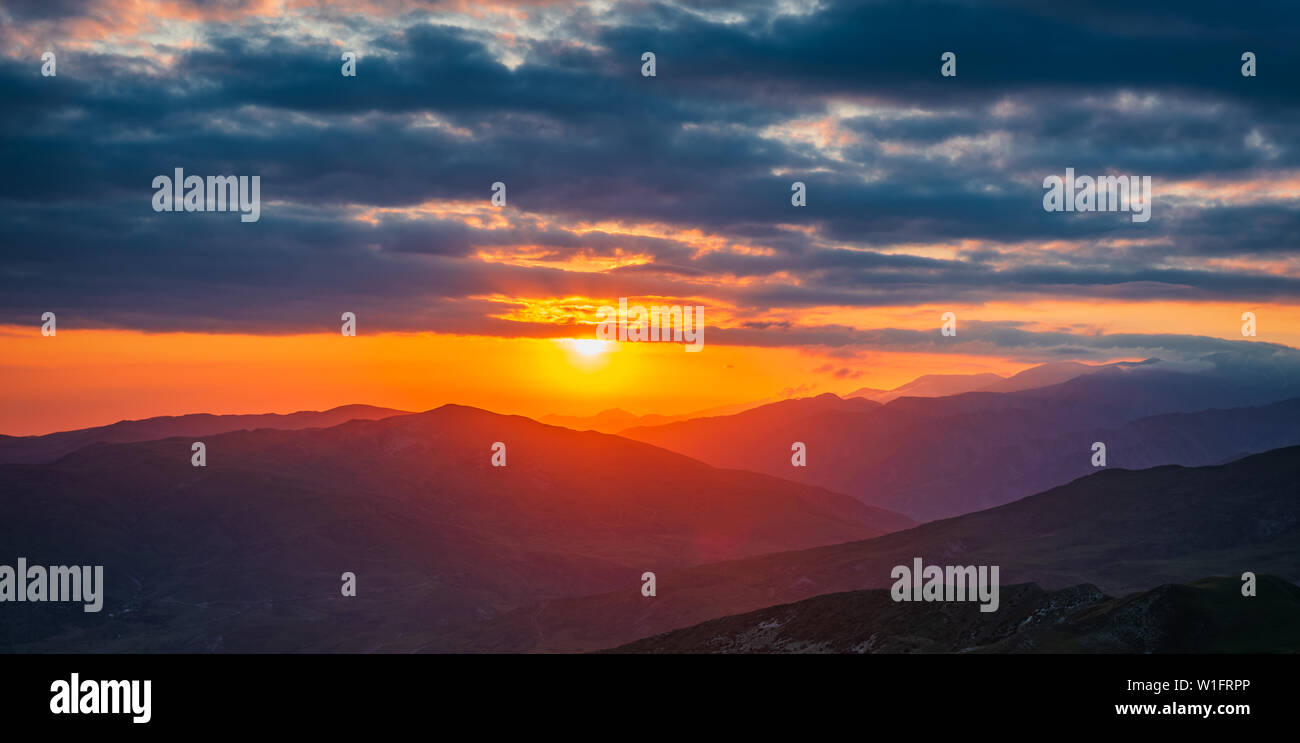 Colorful sunset in the mountains - Stock Image
