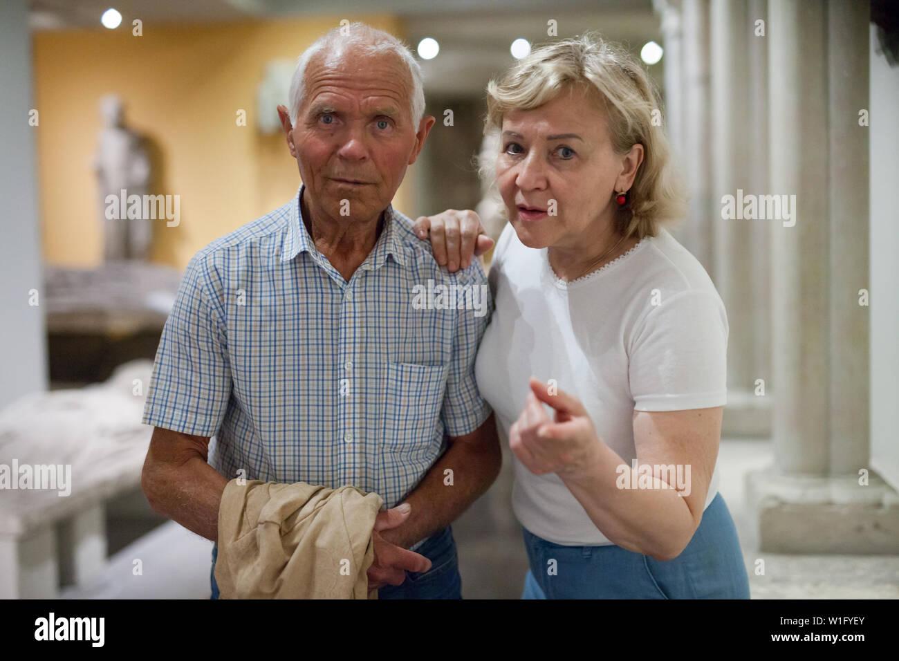 Portrait of senior couple visiting museum of ancient art - Stock Image