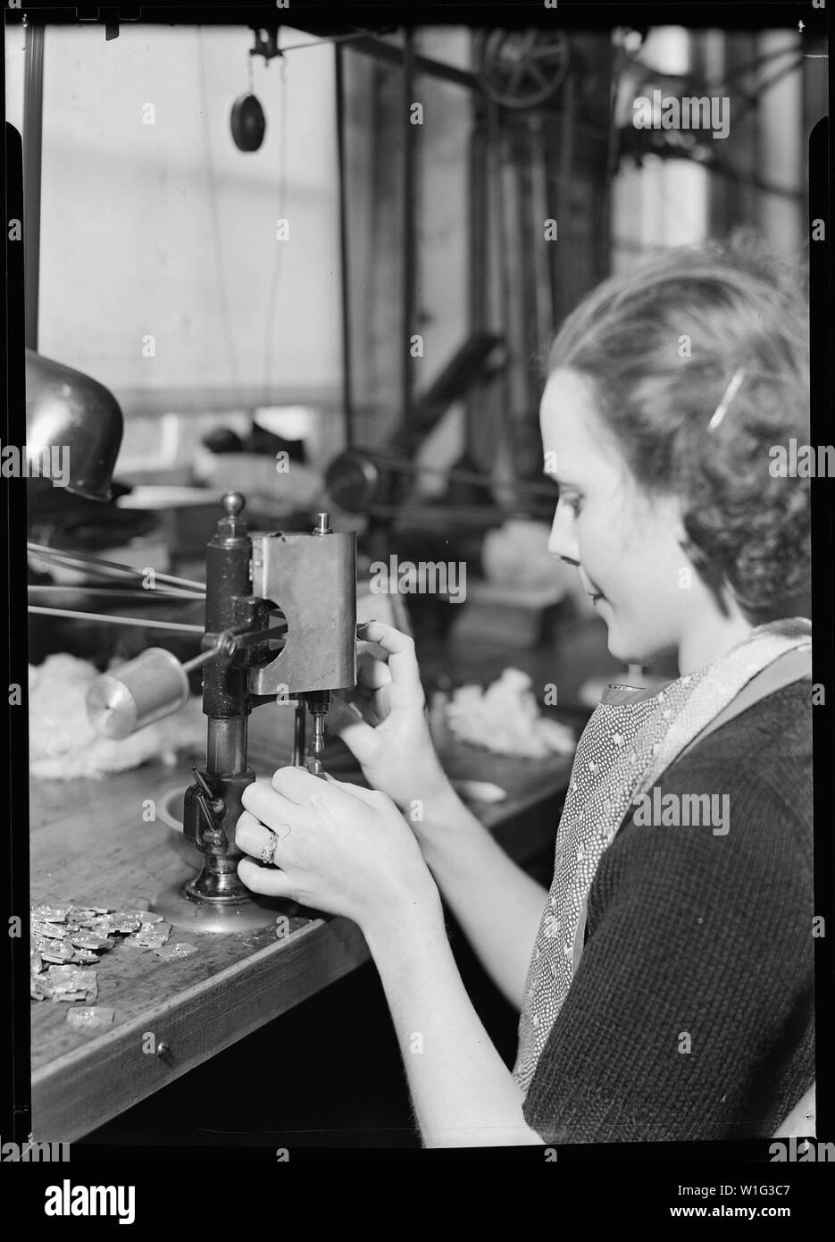 Lancaster, Pennsylvania - Hamilton Watch . Operation - tapping dial foot - simple operation for threading holes in parts. - Stock Image