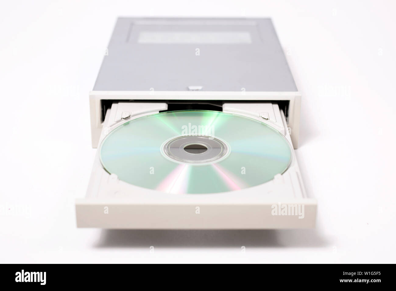 open dvd-rom isolated on a white background. - Stock Image