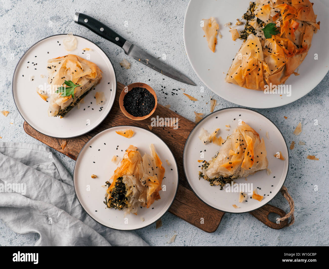 Greek Pie Spanakopita On Gray Background Ideas And Recipes For Vegetarian Or Vegan Spanakopita Spinach Pie From Fillo Pastry Slices Pie On Plates Copy Space Top View Or Flat Lay Stock Photo