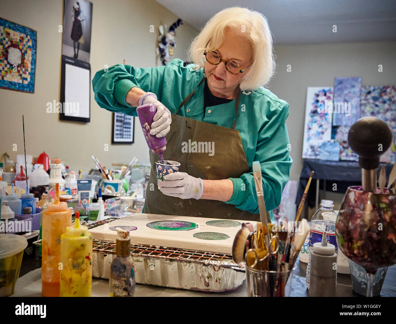 retired lady creating art in a home studio Stock Photo