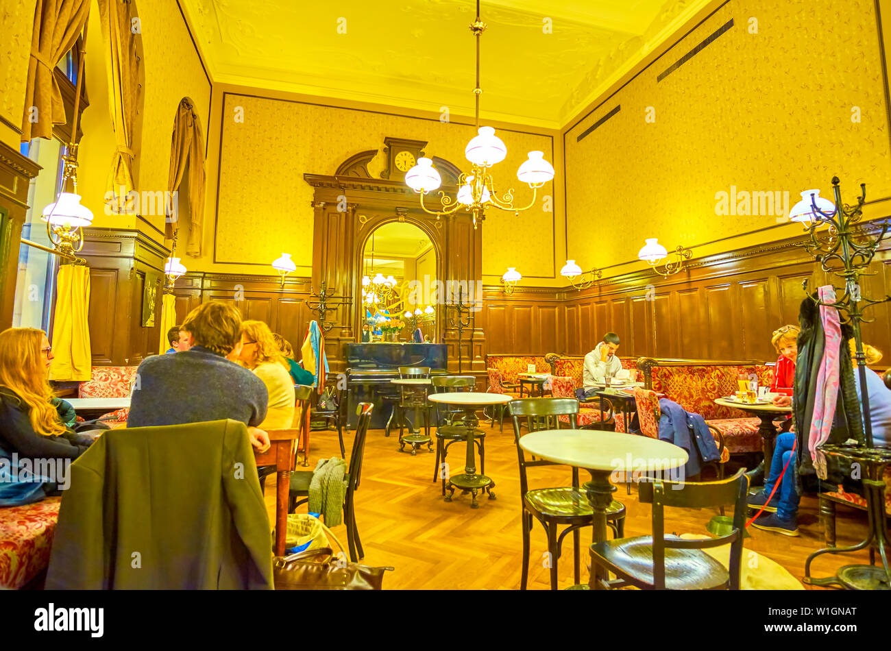 VIENNA, AUSTRIA - FEBRUARY 18, 2019: The cozy Cafe Sperl with vintage interior and furniture is the best place to spend evening time, drinking authent - Stock Image