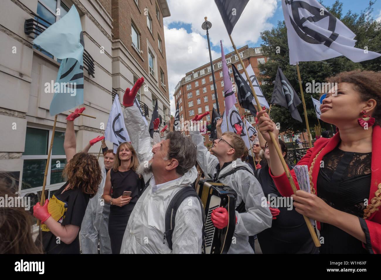 London, UK  2nd July 2019  Extinction Rebellion wave at