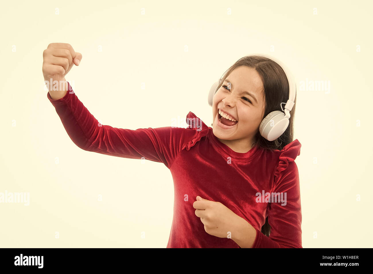 Little girl listen music wireless headphones  Online music channel