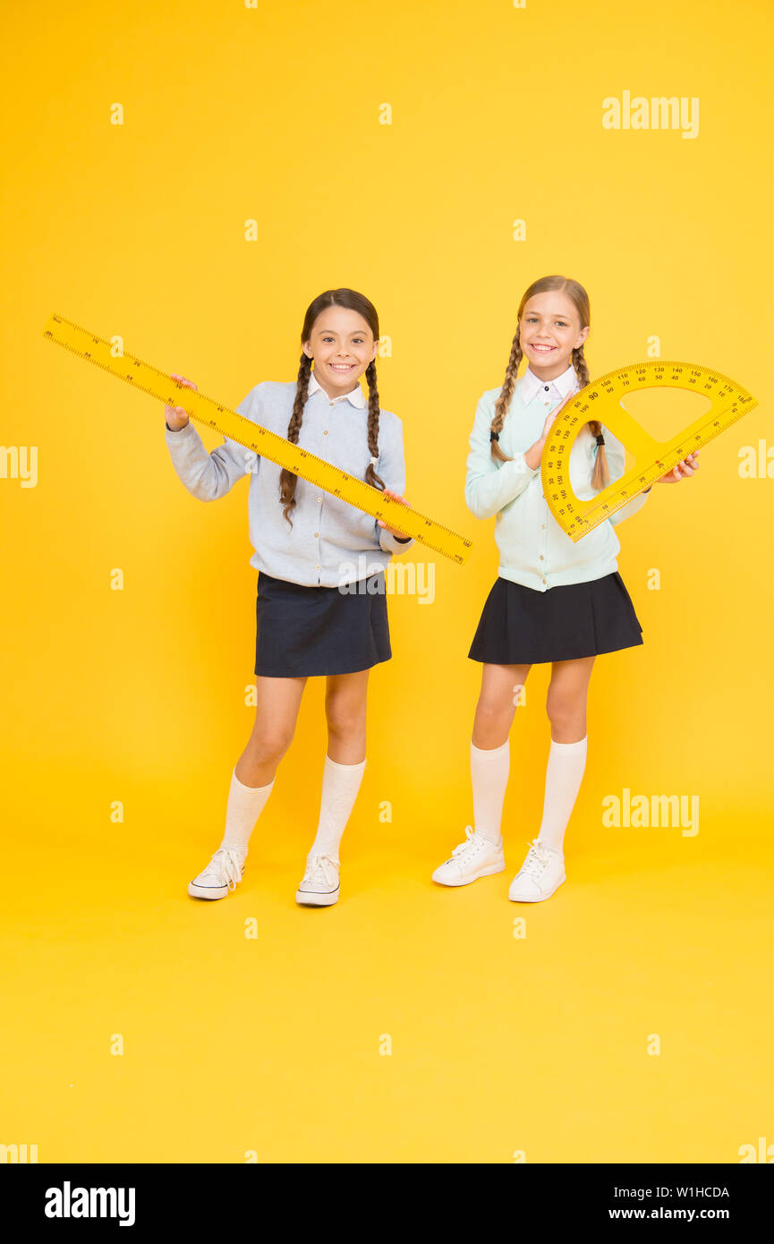 School friendship. School day fun cheerful moments. Kids cute students. Knowledge day. Schoolgirls best friends excellent pupils. Secondary school. Schoolgirls tidy appearance school uniform. - Stock Image