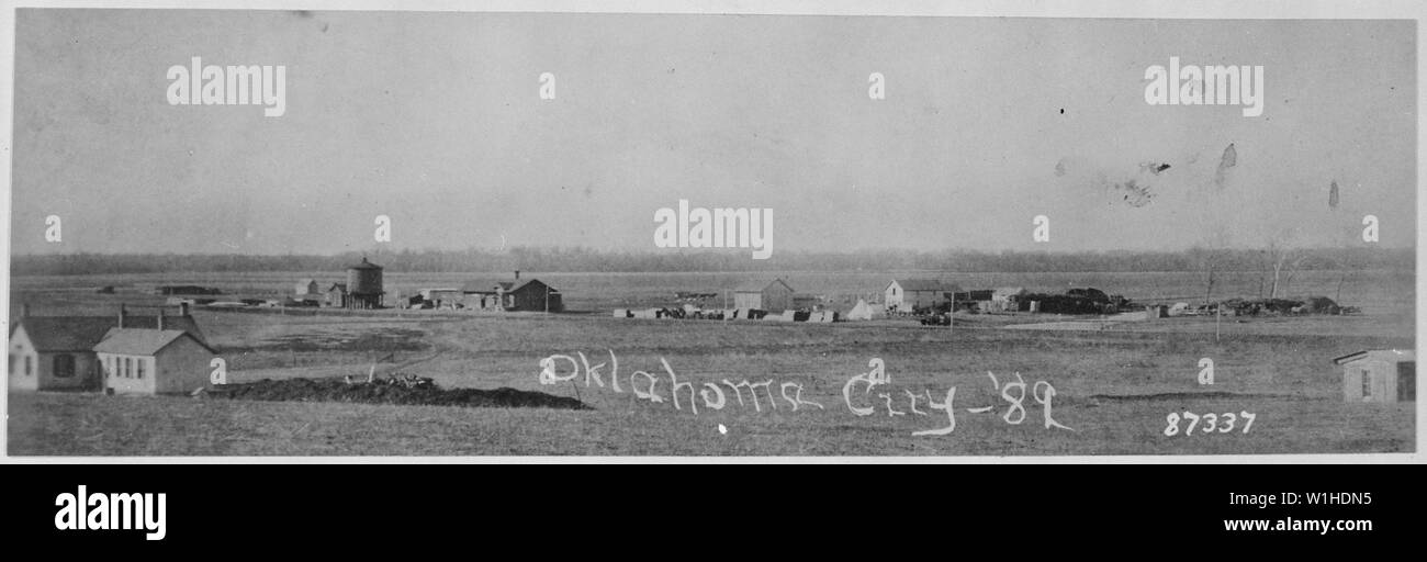 Oklahoma City, Indian. Terr., in 1889 showing U.S. Government dwellings, water tank, railroad station, hotel, post office and store, stage stables, tents of 13th Infantry detachment guarding lumber and an uncompleted cemetery - Stock Image