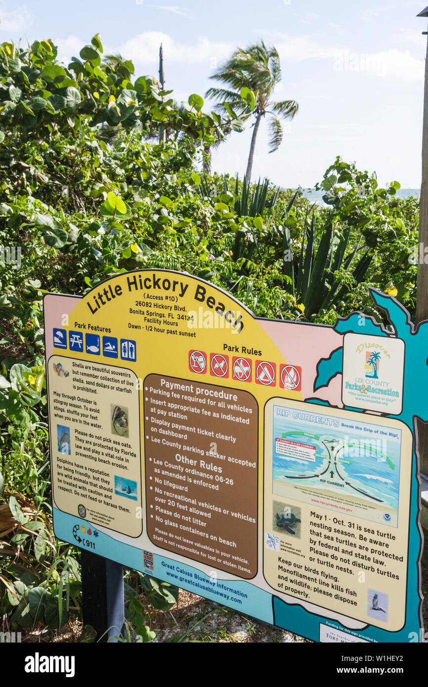 Florida Bonita Springs Gulf of Mexico public beach Little Hickory Beach park rules sign safety information regulations public be - Stock Image