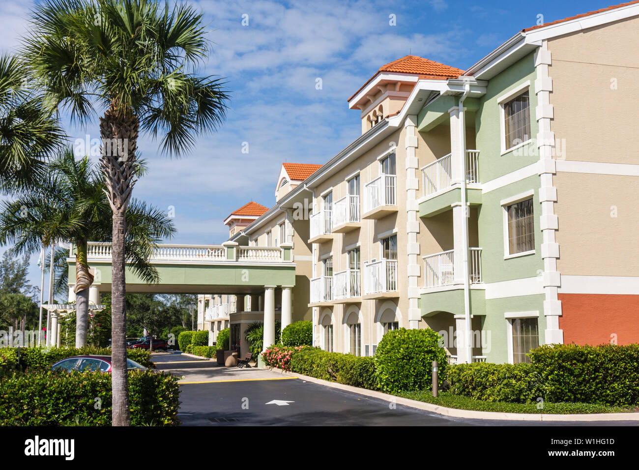 Naples Florida Hilton DoubleTree Guest Suites chain business hotel motel lodging three-story building exterior balcony entrance - Stock Image
