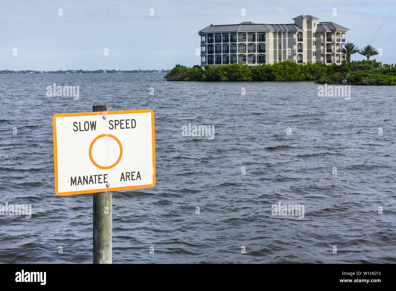 Melbourne Florida Indian River waterfront coastal area condominium building four story pylon sign manatee area slow speed endang Stock Photo