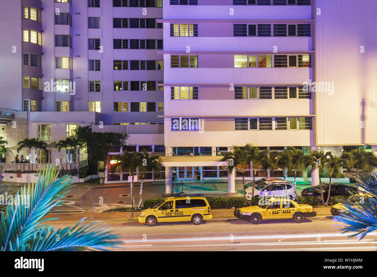 Miami Beach Florida Collins Avenue night street taxi taxicab stand hotel entrance window view from above - Stock Image