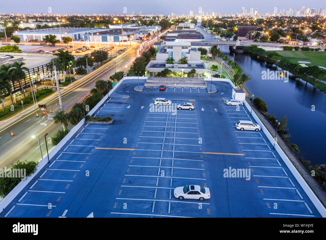 Miami Florida canal downtown skyline dusk rooftop parking lot car canal street city lights Stock Photo
