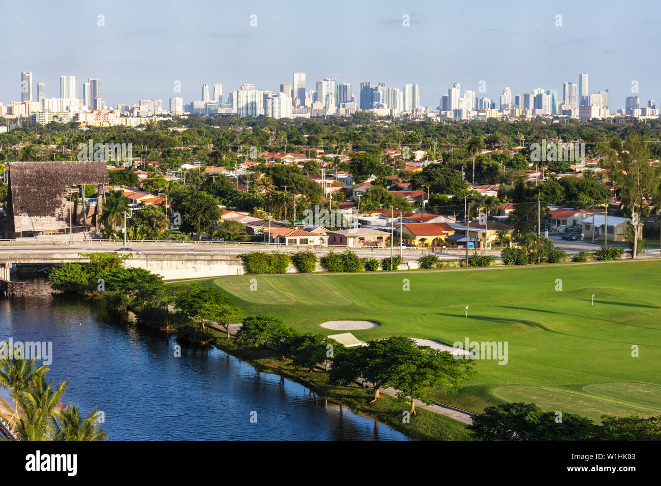 Miami Florida canal downtown skyline buildings panoramic urban golf course trees green houses Stock Photo