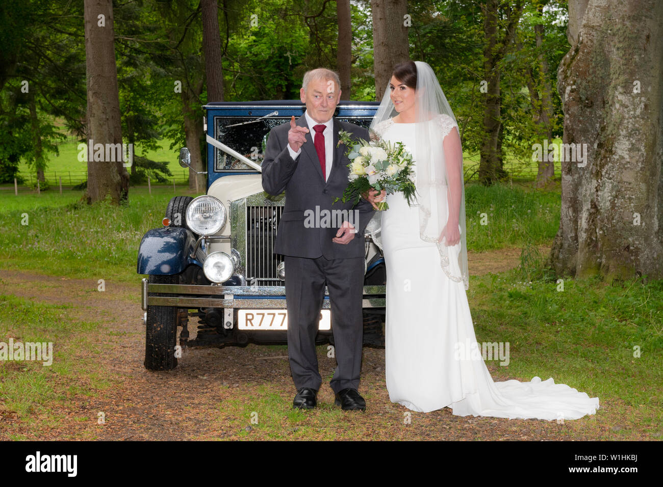 A bride and her Grandfather from a Scottish wedding which took place on the Belladrum Estate, Kiltarlity, Inverness-shire. - Stock Image