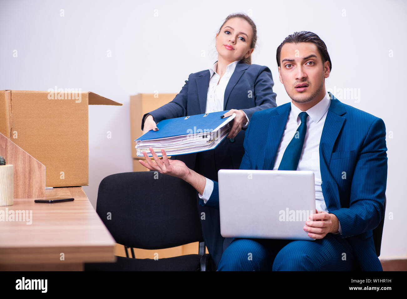 Two employees being fired from their work - Stock Image