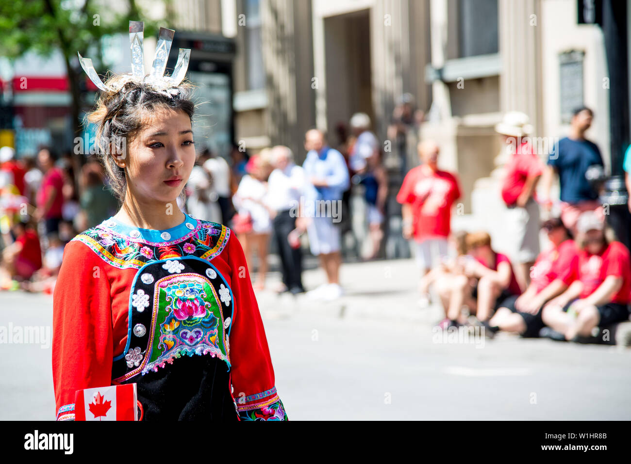 The chinese ethics show and the dragon dance in the Canada day parade in downtown Montreal - Stock Image
