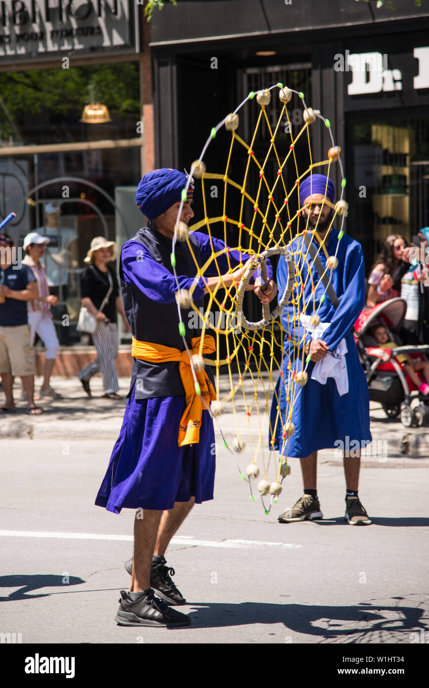 The parade of Canada Day in downtown Montreal - Stock Image