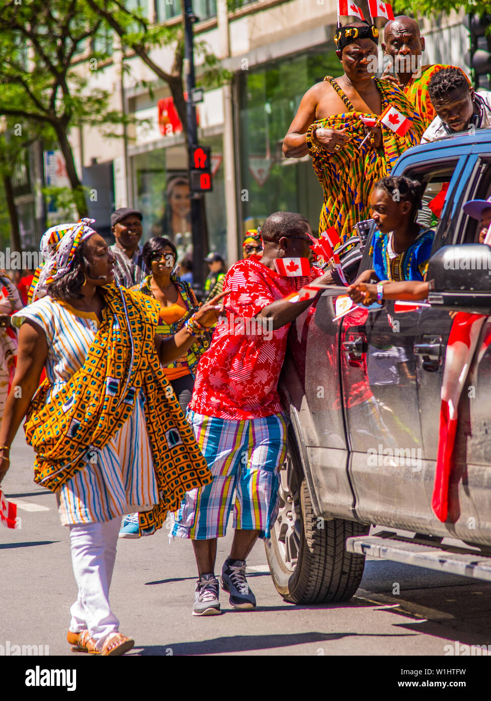 The parade of Canadian National Day in downtown Montreal - Stock Image