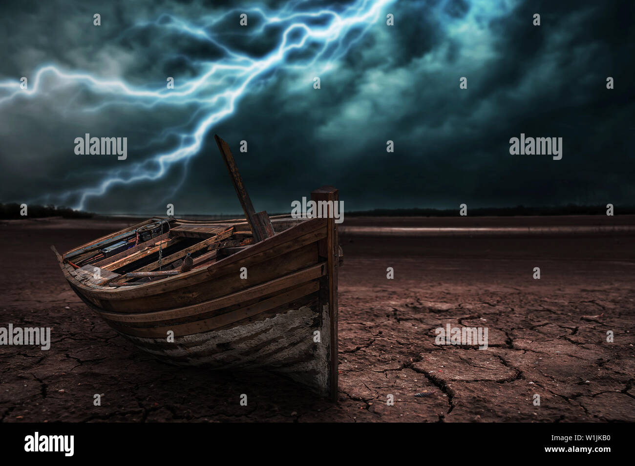 Boat crash land to the ground dry and cracked. With lightning storm - Stock Image