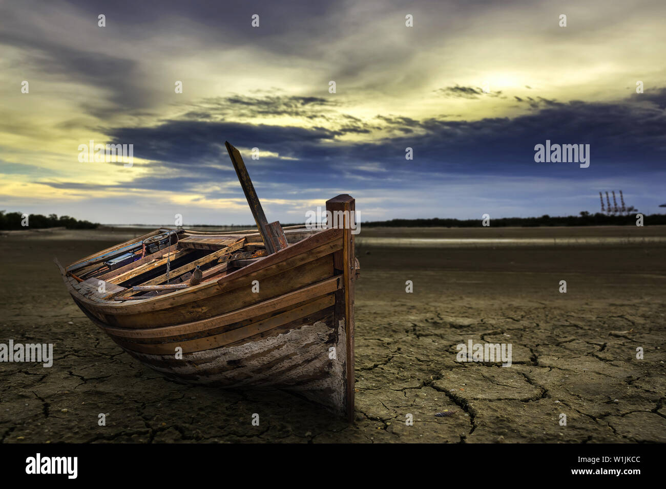 Boat crash landing land with dry and cracked ground. Desert - Stock Image