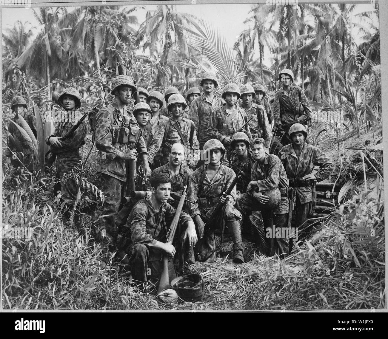 These men have earned the bloody reputation of being skillful jungle fighters. They are U.S. Marine Raiders gathered in front of a Japanese dugout on Cape Torokina on Bougainville, Solomon Islands, which thry helped to take.; General notes:  Use War and Conflict Number 1200 when ordering a reproduction or requesting information about this image. - Stock Image