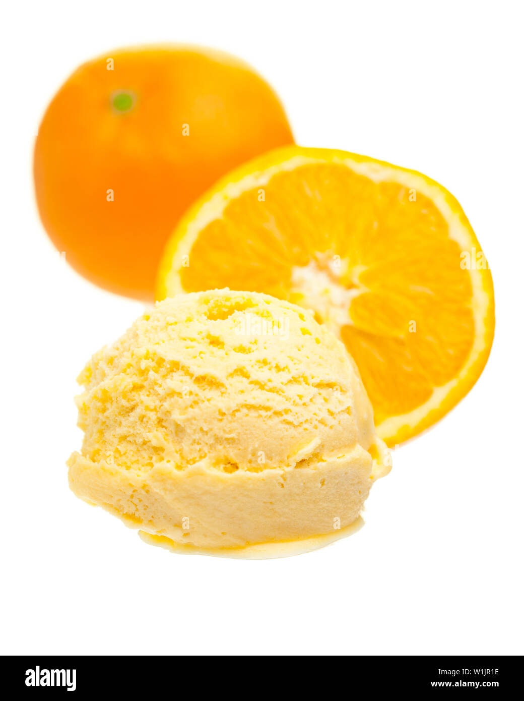 Orange Ice Cream Scoop In Front Of Oranges On White
