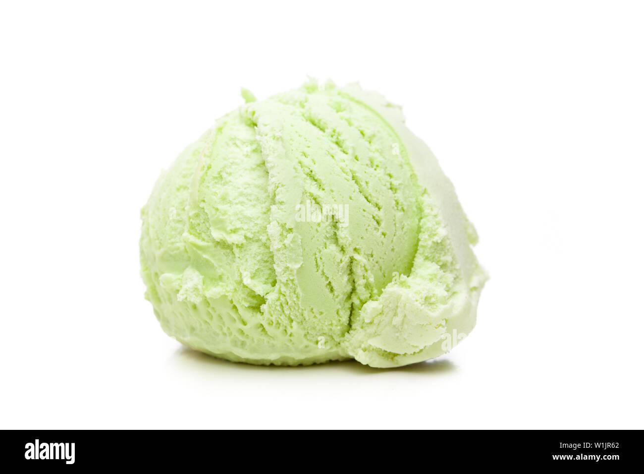 A scoop of pistachio ice cream isolated on white background Stock Photo