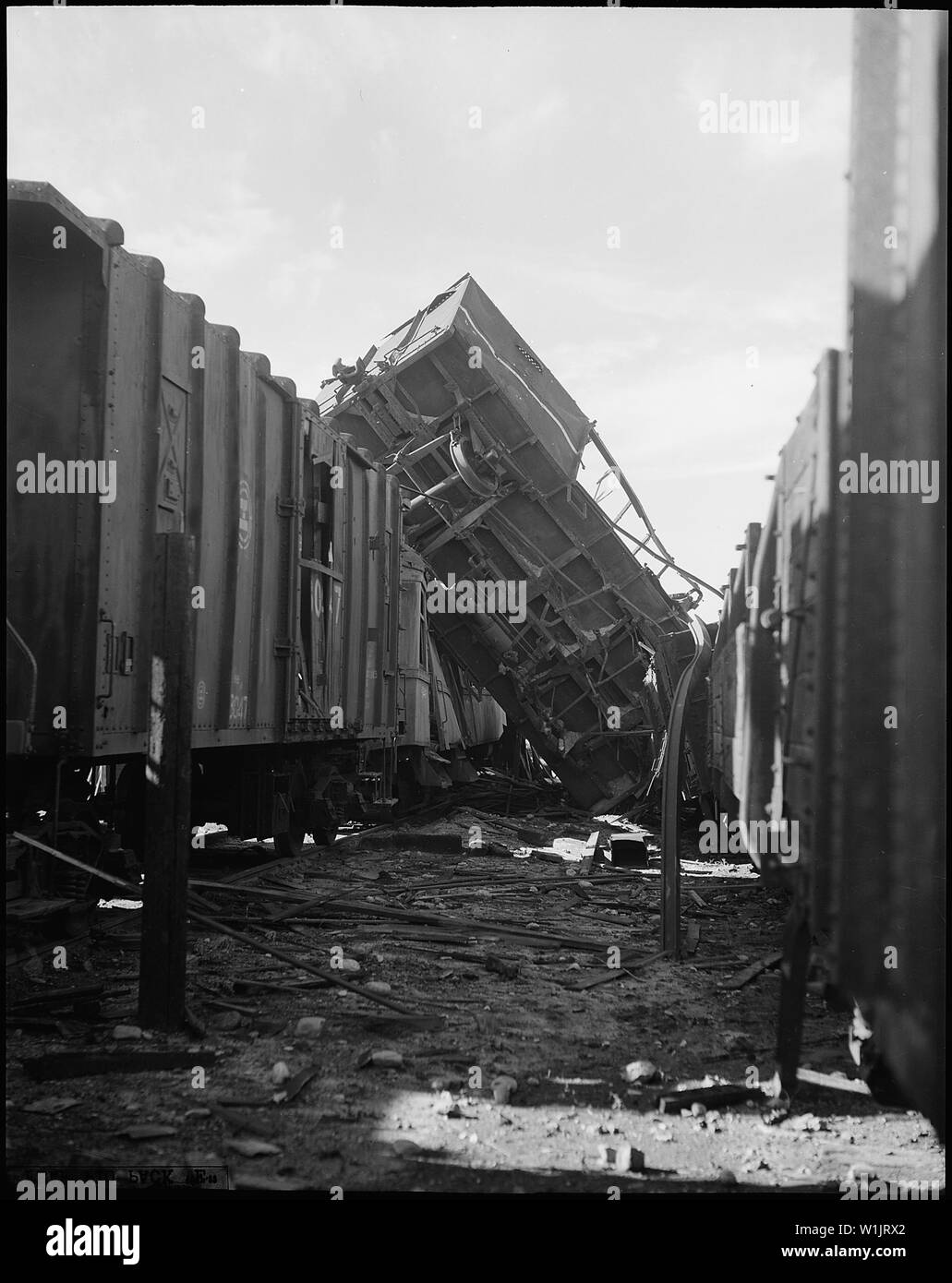 This photograph vividly portrays the results of aerial bombing. When bombs from a B-29 formation thundered through this Communist railroad yard at Pyongyang, Korea, N.W., the force of an explosion twisted steel rails like wet spaghetti and tossed this huge gondola into the air and smashed it into a string of box cars. As soon as the Communists repair this yard, photo reconnaissance will again flash the green light and rail cars will dance to the Air Force tune once more. - Stock Image