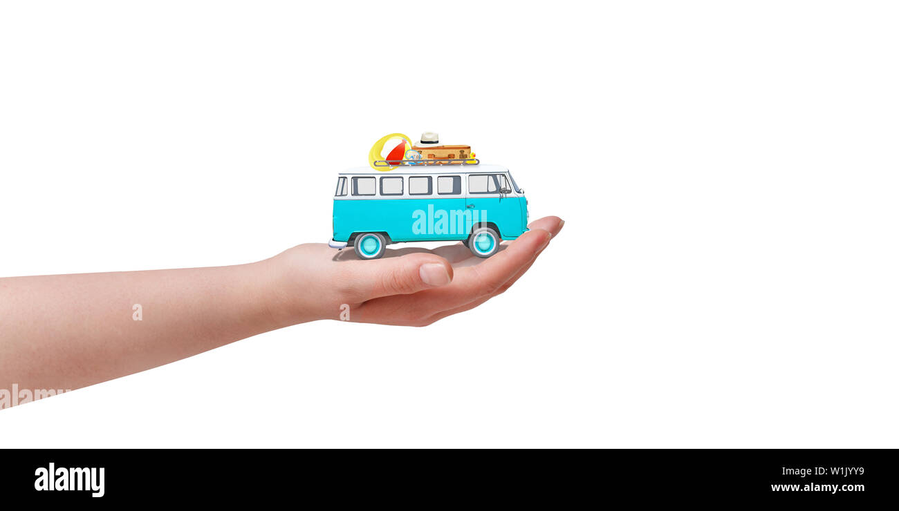 Isolated old blue van in hand. Travel concept. - Stock Image