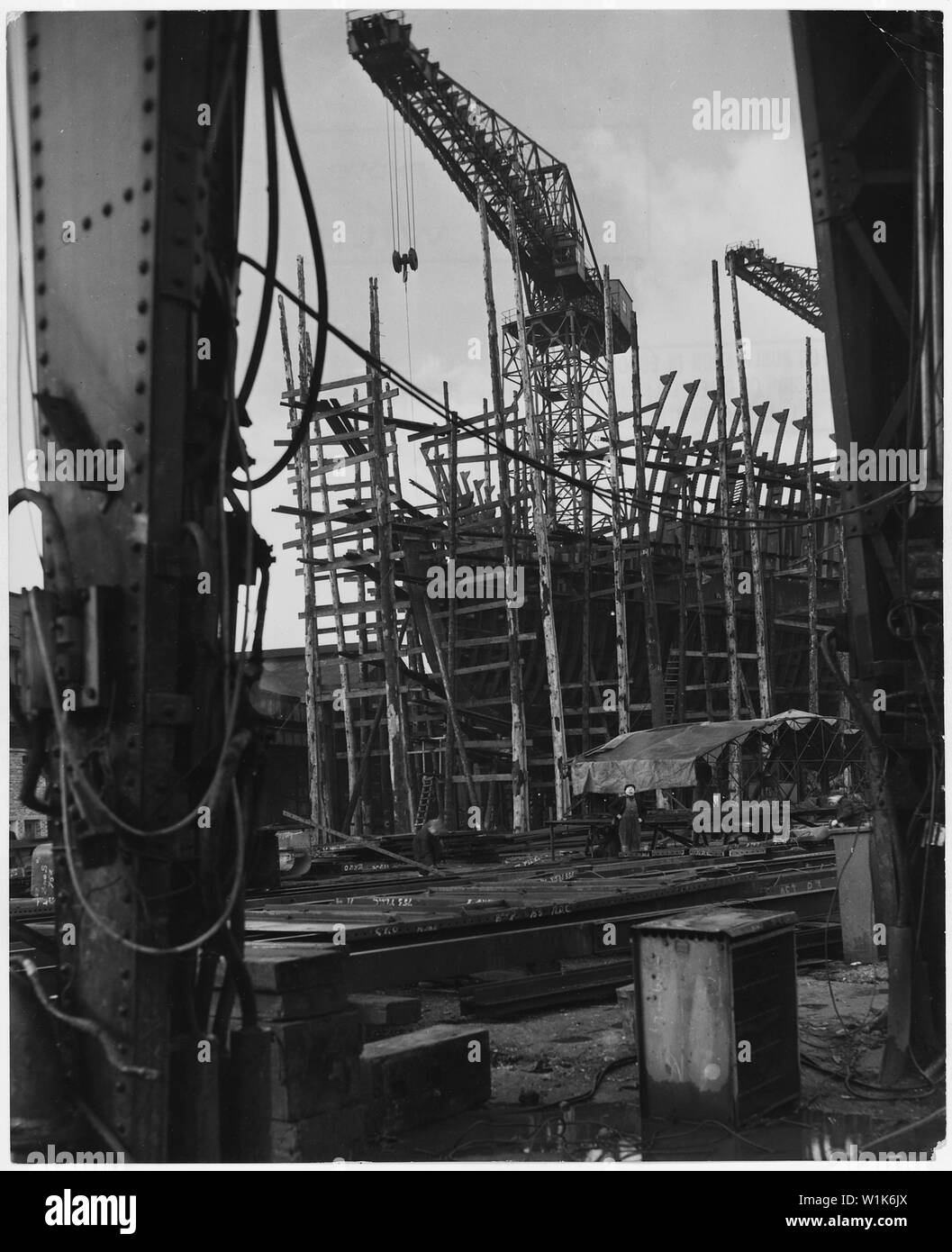 United Kingdom. Clydebank, Scotland. Still a shapless frame work of steel scaffolding, this 28,000 ton oil tanker, building in the Clydebank yard of Fairfield Shipbuilding and Engeering Comapny, is due for launching within two months (April-May) - and Clydebank never misses the deadline; Scope and content:  United Kingdom. Clydebank, Scotland. Still a shapless frame work of steel scaffolding, this 28,000 ton oil tanker, building in the Clydebank yard of Fairfield Shipbuilding and Engeering Comapny, is due for launching within two months (April-May) - and Clydebank never misses the deadline. Br Stock Photo