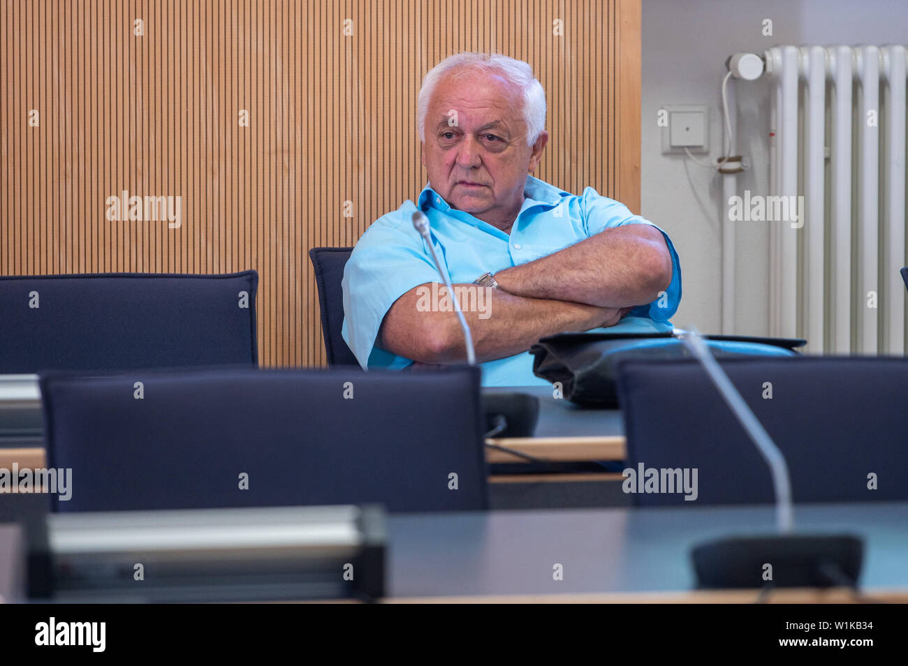 03 July 2019, Bavaria, Regensburg: Norbert Hartl, former leader of the SPD parliamentary group in the city council, sits in the courtroom of the regional court. The court acquitted Hartl because it found no misconduct in the sense of aiding and abetting Wolbergs. Photo: Armin Weigel/dpa Stock Photo