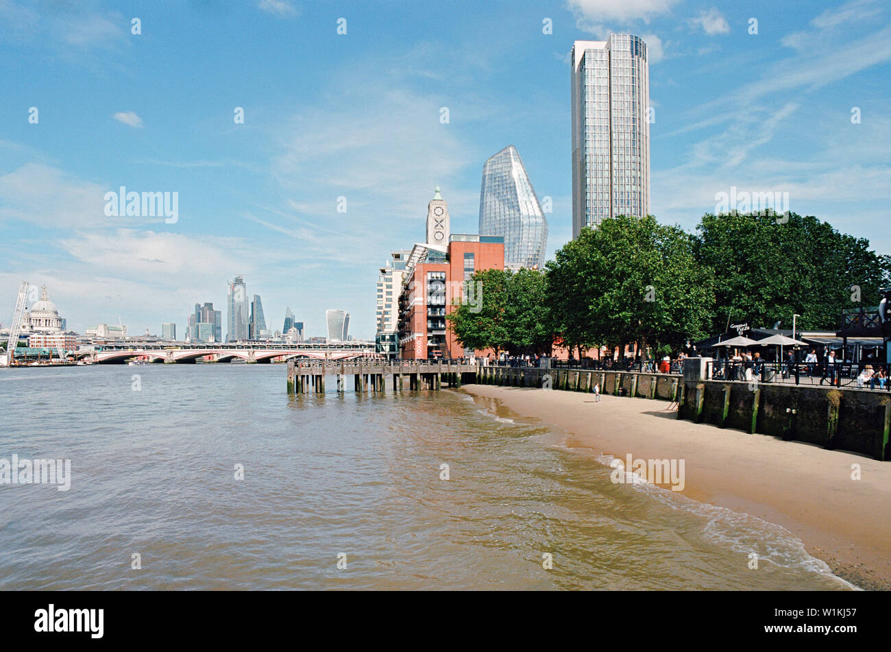 The South Bank of the River Thames, Central London, looking East towards the Oxo Tower, the South Bank Tower, One Blackfriars and the city Stock Photo