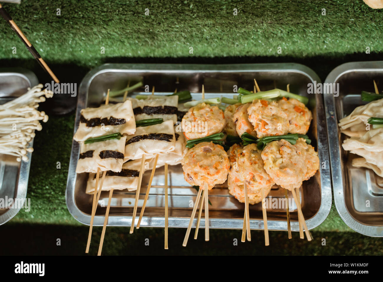 Traditional chinese street food on the wooden skewers Stock Photo