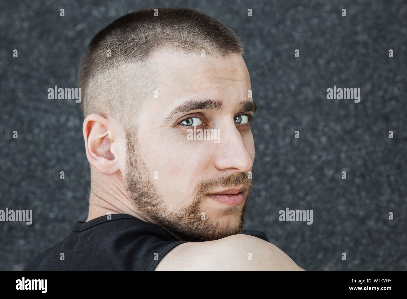 Caucasian man preparing for the start of the sprint. stadium, rubber track. athletics competitions. Track and field runner in sport uniform. athlete, - Stock Image