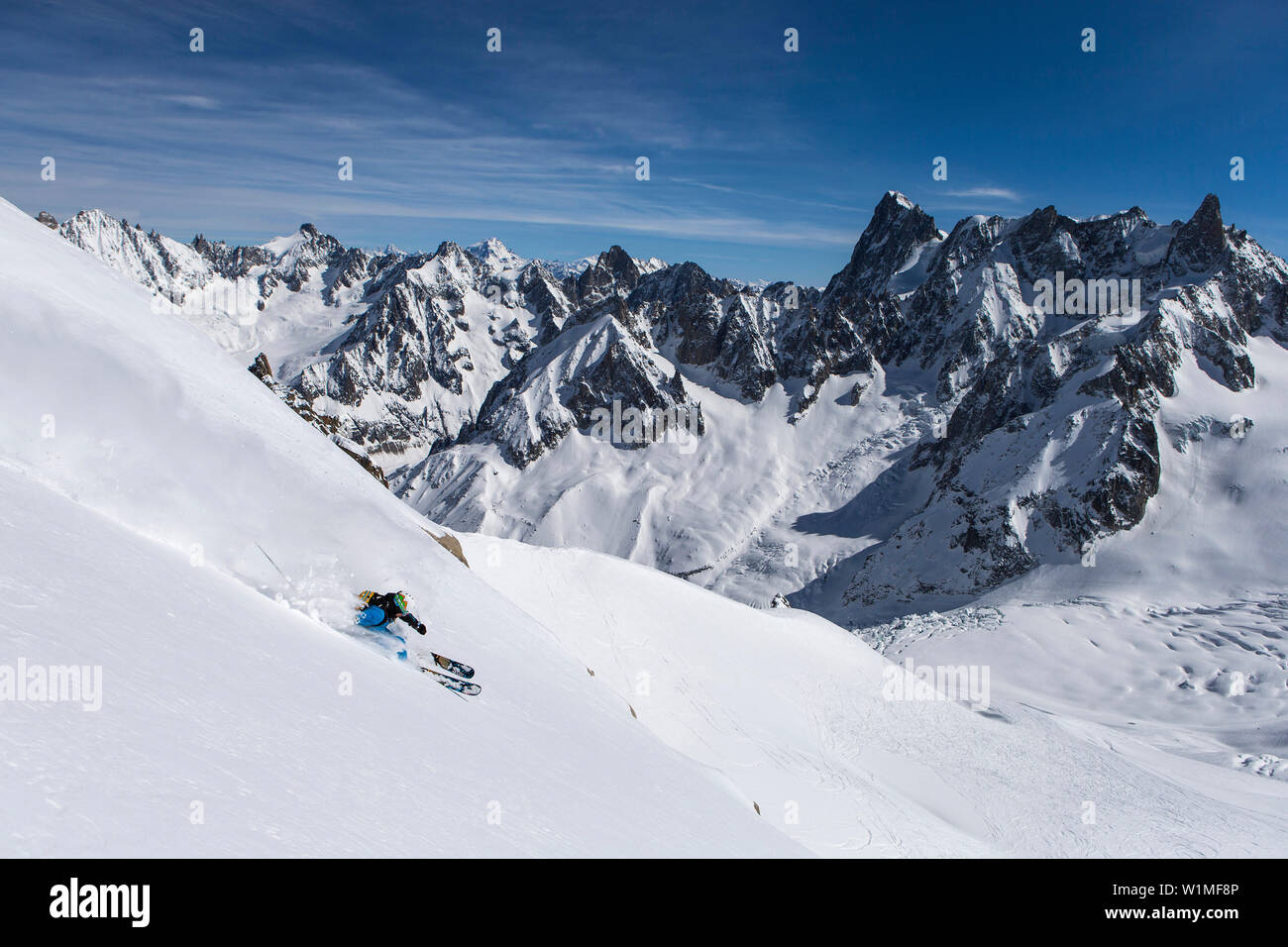 Skier in Vallee Blanche with Grandes Jorasses 4208 m, Aiguille du Midi 3842 m, Chamonix, France - Stock Image