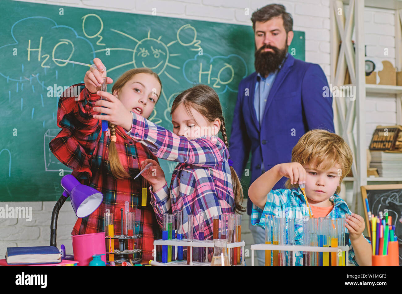 School chemistry laboratory. back to school. Educational concept. Pupils in the chemistry class. happy children teacher. children scientists making experiments in laboratory. Biological samples. - Stock Image