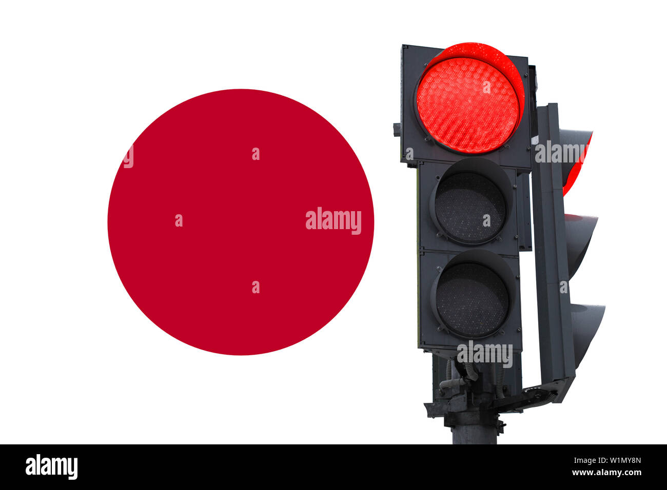 traffic light with a burning prohibitory signal. on the background of the flag of Japan. prohibition of entry - Stock Image