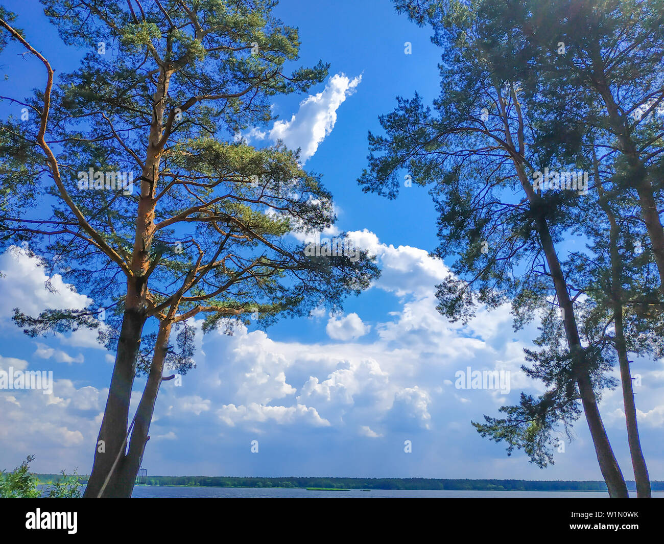 clouds blue sky fishing early in the morning for a picnic - Stock Image